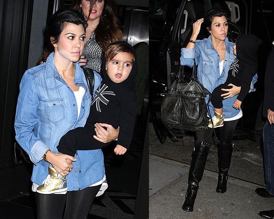 Kourtney Kardashian wearing Valentino Ruffle-trimmed Suede Knee Boots