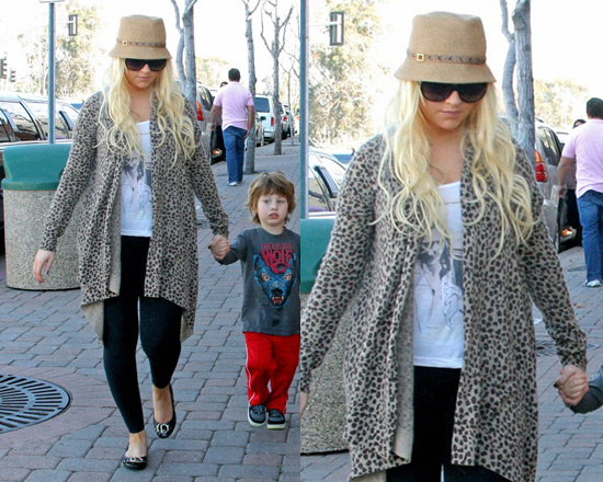 Christina Aguilera stays warm in Autumn Cashmere Leopard Wrap Sweater