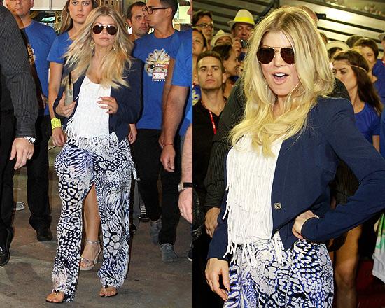 Fergie in Brazil wearing Sauce Fringe Tank and Rebecca Minkoff Kalahari Print Pants