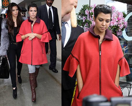Pregnant Kourtney Kardashian covers up in Tibi Novelty Coat
