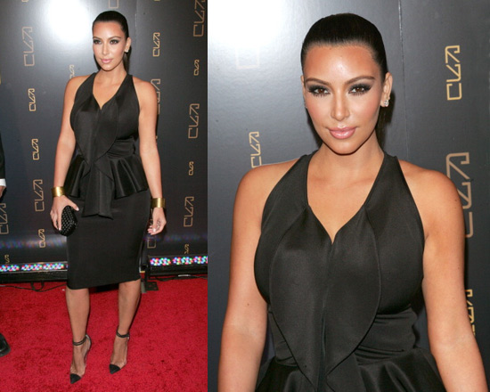 Kim Kardashian at RYU Restaurant Grand Opening wearing Givenchy Shiny Peplum Dress