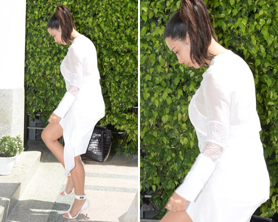 Kim Kardashian wears Givenchy Tiered Chiffon Lace Top with Tails