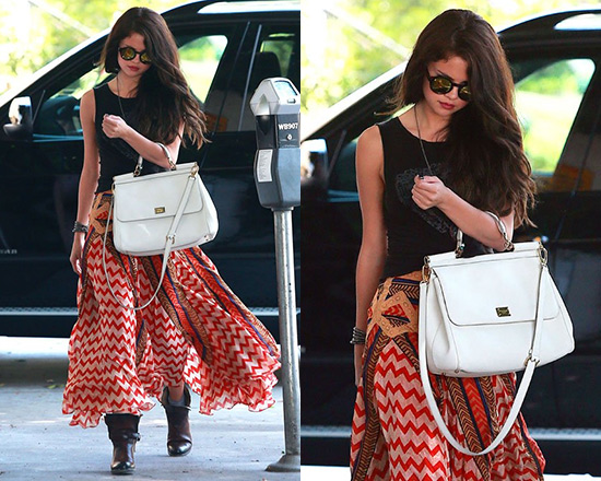 3996d6efefc Selena Gomez steps out in Free People Lotta Stensson Maracana Silk Skirt