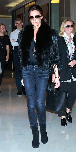 Victoria Beckham wearing a Alaïa suede round-toe boots at the airport in Beijing, China