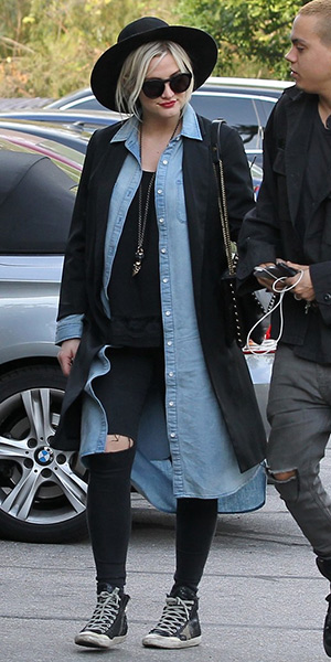 Ashlee Simpson wearing a Lanvin Sugar Studded Shoulder Bag and Golden Goose sneakers