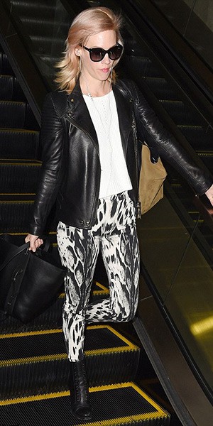 January Jones at LAX wearing a Givenchy leather jacket, Michael Stars sweater and Jimmy Choo combat boots - March 2015