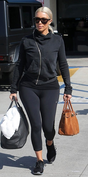 Kim Kardashian steps out in a DRKSHDW By Rick Owens Turtleneck Sweatshirt and Nike shoes - March 2015