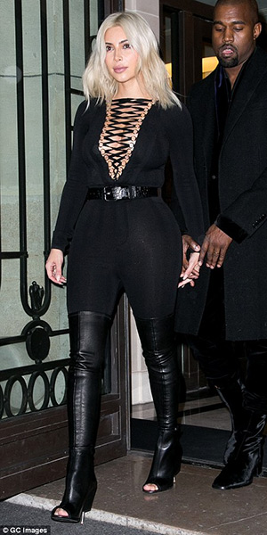 Kim Kardashian in Paris wearing a Givenchy bodysuit and Givenchy Nunka Stretch Nappa Boots