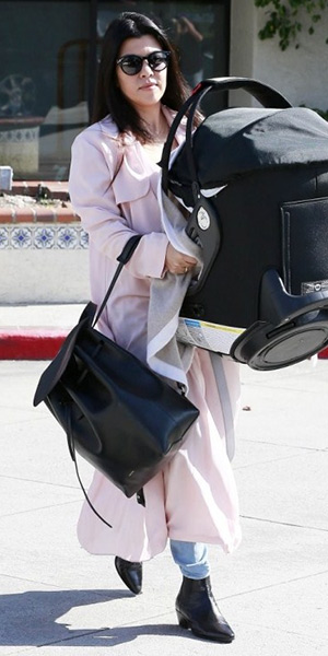 Kourtney Kardashian steps out in a light pink First & I Trench Coat from ASOS and a Mansur Gavriel backpack - March 2015