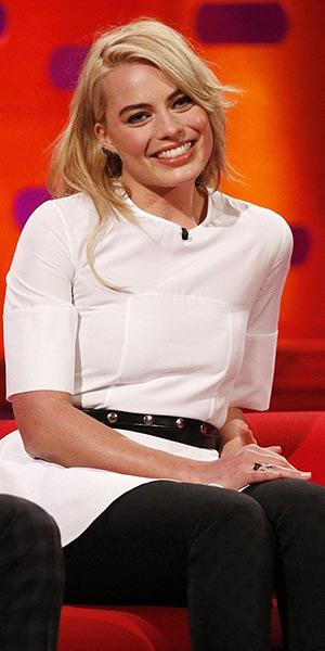 Margot Robbie on UK talk show wearing a Alexander McQueen peplum top