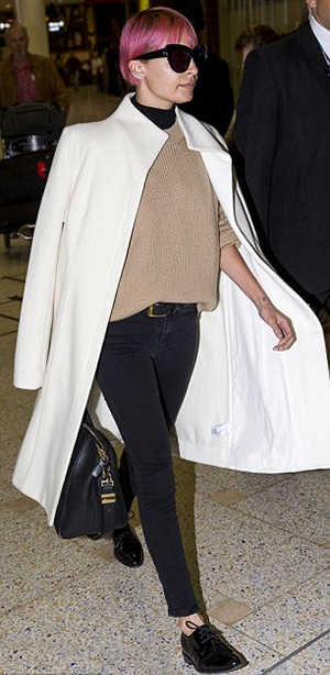 Nicole Richie wearing Ksubi Black Night Spray On Jeans at the airport in Sydney, Australia