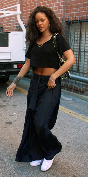 Rihanna wearing Acne Studios Eddiese Wide-Leg Trousers, Dior bag and Puma classic sneakers - March 2015