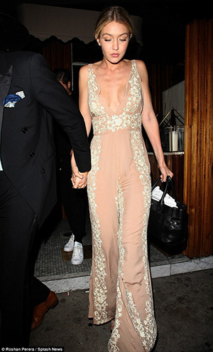 Gigi Hadid wearing a Blue Life Embroidered Jumpsuit to dinner at the Nice Guy in West Hollywood, CA, on April 17, 2015