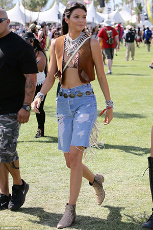 Kendall Jenner at Coachella in a Derek Lam 10 Crosby vest, Isabel Marant bikini and Dylanlex jewelry. Her shorts are by RE/DONE and python ankle boots by Saint Laurent - April 10, 2015