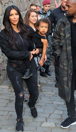 Kim Kardashian sightseeing in Armenia with her daughter North West and husband Kanye West, wearing a pair of Current/Elliott jeans, a Haider Ackermann bomber jacket and Nike shoes - April 9, 2015