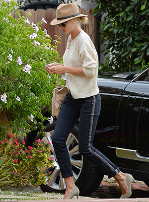 Rosie Huntington-Whiteley visits a friend in L.A. wearing a top and jeans by Etoile Isabel Marent, Chloe sunglasses and Lanvin necklace. Her bag is Givenchy and shoes also Isabel Marant - April 7, 2015