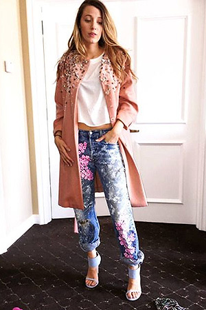 Blake Lively wears a embellished Roland Mouret coat, Rialto splattered jeans and a pair of Stuart Weitzman Showgirl Sandals