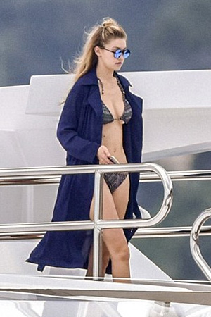 Gigi Hadid was spotted wearing Girls on Film while on a yacht in Monte Carlo with sister Bella Hadid and Kendall Jenner.