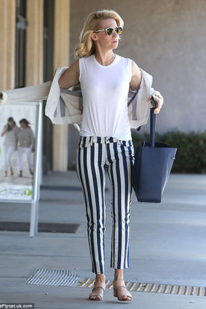 January Jones runs errands in Sherman Oaks in a pair of Seafarer Lord Jim Striped Jeans and a Burberry Linen biker jacket - April 28, 2015