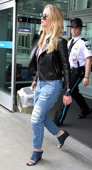 Jennifer Lawrence arrives in Montreal to shoot the new X-Men movie, wearing The Row for Linda Farrow Gallery sunglasses and Balenciaga Studded Glove Wedge Slides - May 18, 2015