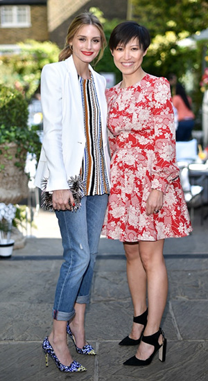 Olivia Palermo attends Jimmy Choo tea party in London, wearing a Zara top, Jimmy Choo Ava Glossy Snakeskin with Rock Metal Fringes Clutch Bag and Jimmy Choo Avril Violet and Yellow Floral Printed Jacquard Pointy Toe Pumps - May 21, 2015