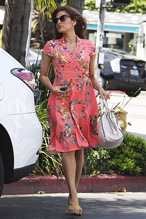 Eva Mendes, in a New York & Co. Eva Mendes Collection Marina Wrap Dress, is seen leaving a hair salon on April 29, 2015 in Los Angeles, CA.