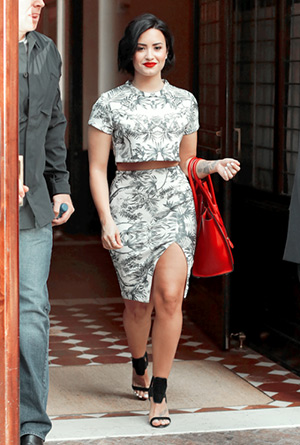 Demi Lovato steps out Nookie and Gianmarco Lorenzi front panel sandals in New York City on June 6, 2015.