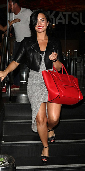 Demi Lovato wearing a Christopher Kane leather jacket, Leith knot front dress, a Celine bag and Gucci Leila shoes while leaving Katsuya restaurant in Hollywood, CA on June 17, 2015.