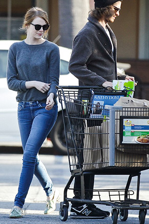 Emma Stone wearing Alexa Chung for AG Brianna skinny jeans while grocery shopping at Ralphs with boyfriend Andrew Garfield in Brentwood, CA on June 5, 2015.