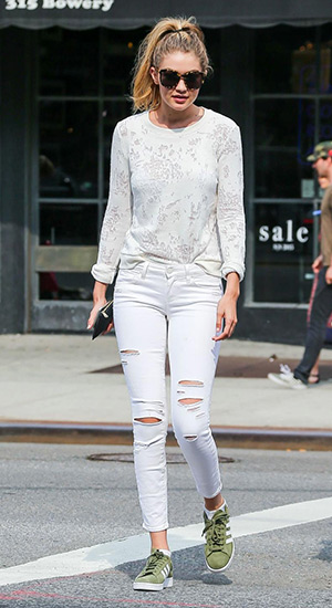 Gigi Hadid is seen out and about with friends in a Paige Denim Josette Sweatshirt and jeans and Adidas shoes in New York City on June 11, 2015.