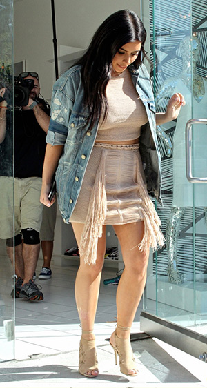 "Kim Kardashian wearing a R13 Oversize Trucker Jacket, Magda Butrym skirt and Aquazzura leaving her DASH store on Melrose after doing some filming for ""Keeping Up With The Kardashians"" on June 16, 2015."