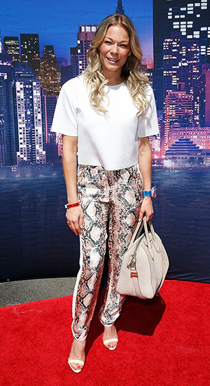 LeAnn Rimes in H&M Apricot Patterned Silk Pants and a Givenchy bag at the Marvel Universe LIVE! Celebrity premiere in Inglewood, CA on May 2, 2015.