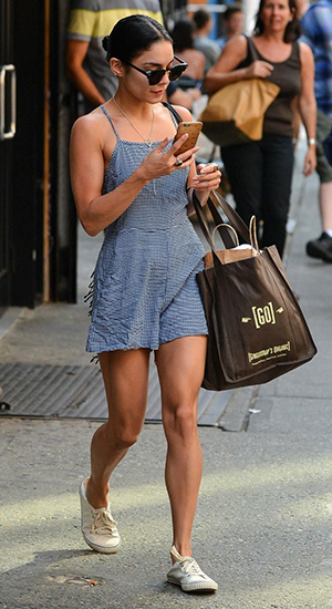 Vanessa Hudgens, wearing a Gingham Print Crossback Romper, is seen leaving her apartment in New York City on June 11, 2015.
