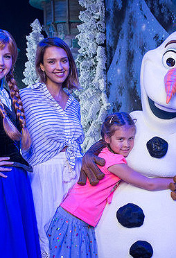 Jessica Alba posing in a Elizabeth and James Emmanuelle Shirt with her family during a tour at the Walt Disney world Resort.