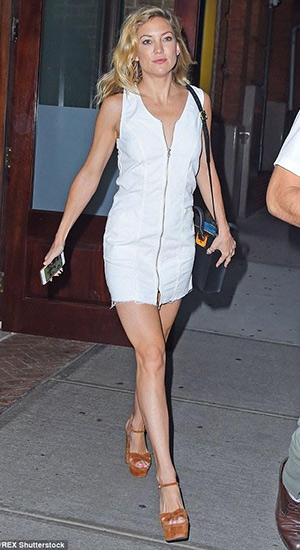 Kate Hudson is seen out and about in a Topshop Cord Zip Front Dress, Sophie Hulme bag and Kurt Geiger shoes in Soho on July 9, 2015 in New York City.