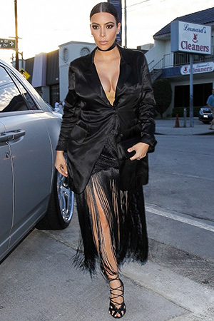 Kim Kardashian arriving at Craig's restaurant in a Proenza Schouler Woven Long Fringe Skirt in Hollywood, CA on July 13, 2015.