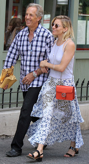 Sienna Miller, wearing a Stella McCartney embroidered skirt, walks arm-in-arm with her father in Manhattan, New York on July 24, 2015.