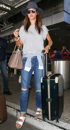 Alessandra Ambrosio wearing a Solid & Striped The French Terry Pullover, Minnie Rose top and Birkenstock Arizona Sandals at LAX airport on July 27, 2015 in Los Angeles, CA.