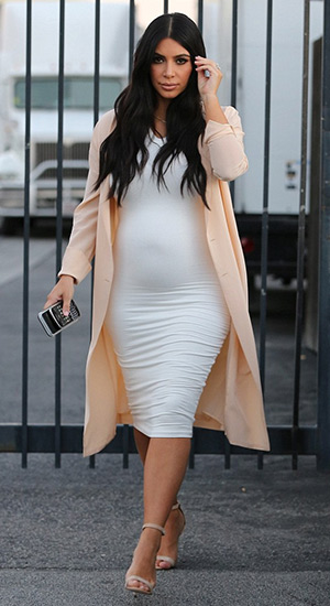 Kim Kardashian wearing a Maison Margiela Crepe De Chine Dress as a coat and a Wolford Bilboa dress while leaving a studio in Los Angeles, CA on July 27, 2015.