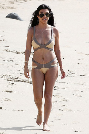 Kourtney Kardashian wearing a Agent Provocateur Mazzy Metals Triangle Cut Out Bikini to the beach in St. Barts during a family vacation in August, 2015.