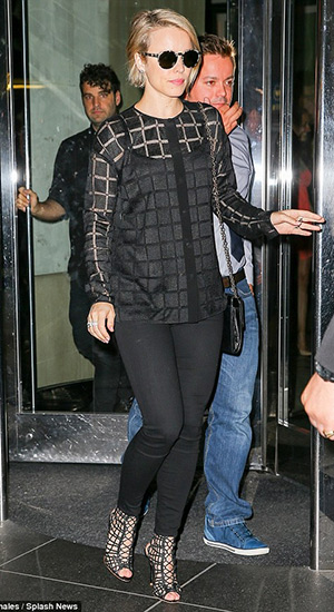 Rachel McAdams wearing a Emanuel Uungaro Checkered Lace Shirt, Etnia Barcelona sunglasses, J Brand pants and Sophia Webster 'Delphine' Cage Booties headed to Hamilton on Broadway in New York City on July 27, 2015.
