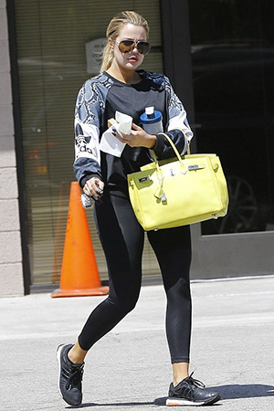 7b59451d85a20 Khloe Kardashian wearing a adidas Originals LA printed jersey sweatshirt  while leaving an office building in