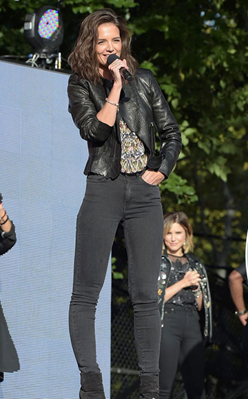 Katie Holmes wearing a Isabel Marant leather jackets, Isabel Marant Smocked Prue Blouse, Saint Laurent jeans and Rag & Bone boots while onstage at the 2015 Global Citizen Festival in New York City on September 26, 2015.