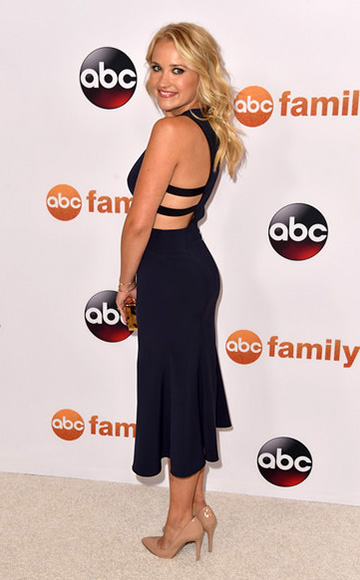 Emily Osment wearing a NBD x REVOLVE Split Sides Dress to Disney ABC Television Group's 2015 TCA Summer Press Tour on August 4, 2015 in Beverly Hills, CA.