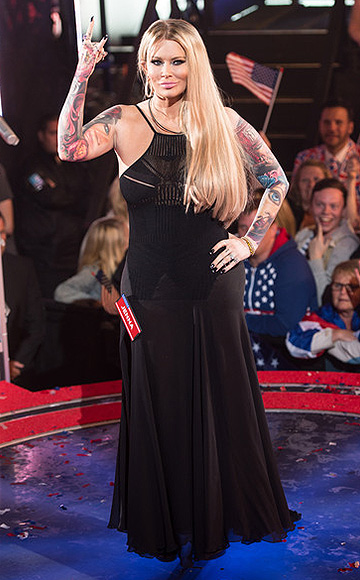 Jenna Jameson wearing a black crochet maxi dress while posing for photographers before entering the Celebrity Big Brother UK house at Elstree Studios on August 27, 2015 in Borehamwood, England.