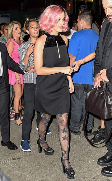 Katy Perry, in a Maison Margiela Patent-Paneled Wool-Twill Mini Dress and Saint Laurent Candy Crystal Studded sandals, arriving at Le Bain for an after party September 16, 2015 in New York City.