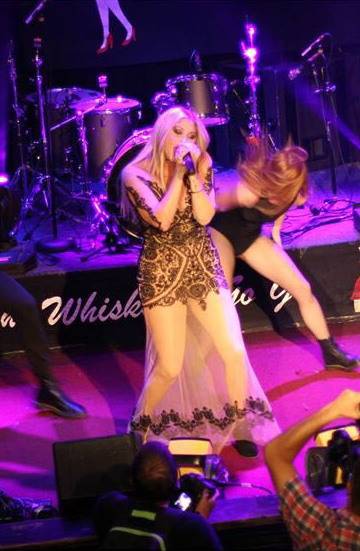 """Taylor Ann Hasselhoff wearing For Love & Lemons Lotus Maxi Dress while performing at the """"Cure Rocks…Where Music + Cause Collide"""" Stopcancer.org Benefit Concert in West Hollywood, CA on October 12, 2015."""