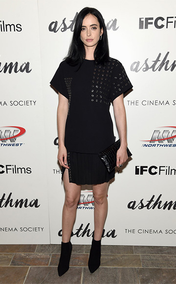 Krysten Ritter wearing a J. Mendel Silk T-Shirt with Metallic Ring Embroidery and matching pleated skirt to the screening her new movie 'Asthma' on October 8, 2015 in New York City. Her shoes are Tory Burch Dorset booties.
