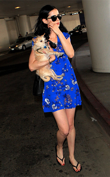 Jessica Jones actress Krysten Ritter, in a Mink Pink Bliss Bloom Dress, carrying her beloved pet pooch Mikey as she departs Los Angeles International airport on September 7, 2015.