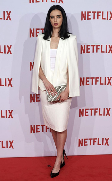 Krysten Ritter wearing a Olcay Gulsen Cape Dress, Elisabeth Weinstock clutch and Pedro Garcia shoes to the Netflix presentation at the Matadero Cultural Center on October 20, 2015 in Madrid, Spain.